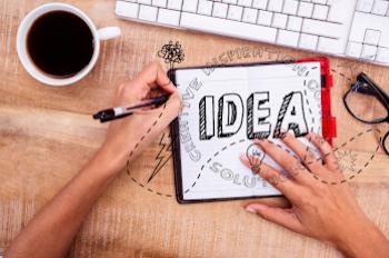 "hands writing ""idea"" - mean idea to make cool websites strony internetowe"